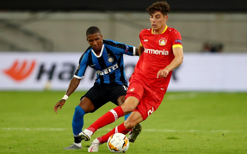 Kai Havertz is closed down by Ashley Young - GETTY IMAGES