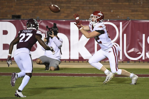 Arkansas tight end Hudson Henry (82) catches a 12-yard touchdown pass during the second half of the team's NCAA college football game against Mississippi State in Starkville, Miss., Saturday, Oct. 3, 2020. Arkansas won 21-14. (AP Photo/Thomas Graning)