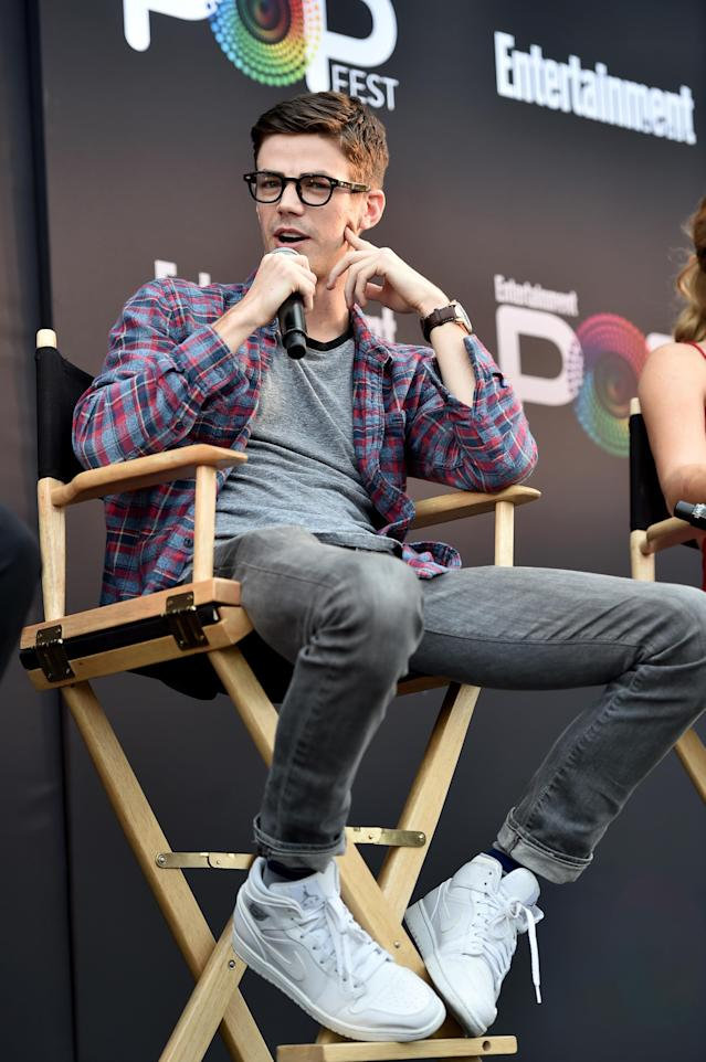 """Grant Gustin speaks during the """"CW Superheroes"""" panel at <em>Entertainment Weekly</em>'s PopFest in Los Angeles on Oct. 29, 2016. (Photo: Alberto E. Rodriguez/Getty Images for Entertainment Weekly)"""