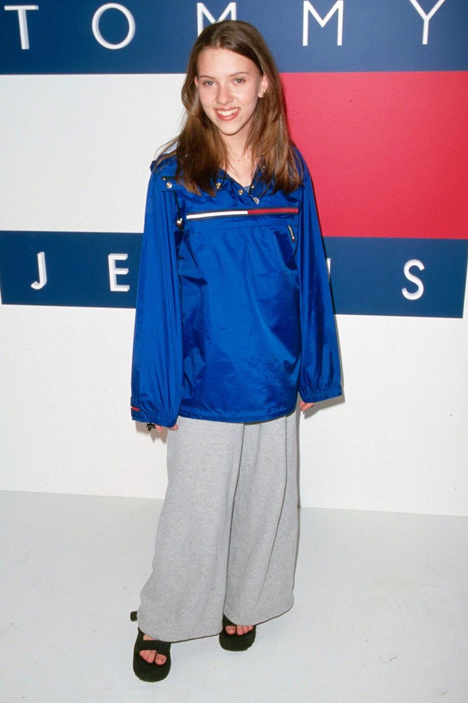 <p>The Tommy Girl paired 2000's hottest outerwear, the anorak, with wide-legged pants at another Tommy Jeans event a couple years later.</p>