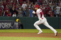Los Angeles Angels designated hitter Shohei Ohtani runs to third after Los Angeles Angels' Jared Walsh hit a single during the ninth inning of a baseball game Friday, July 16, 2021, in Anaheim, Calif. (AP Photo/Mark J. Terrill)
