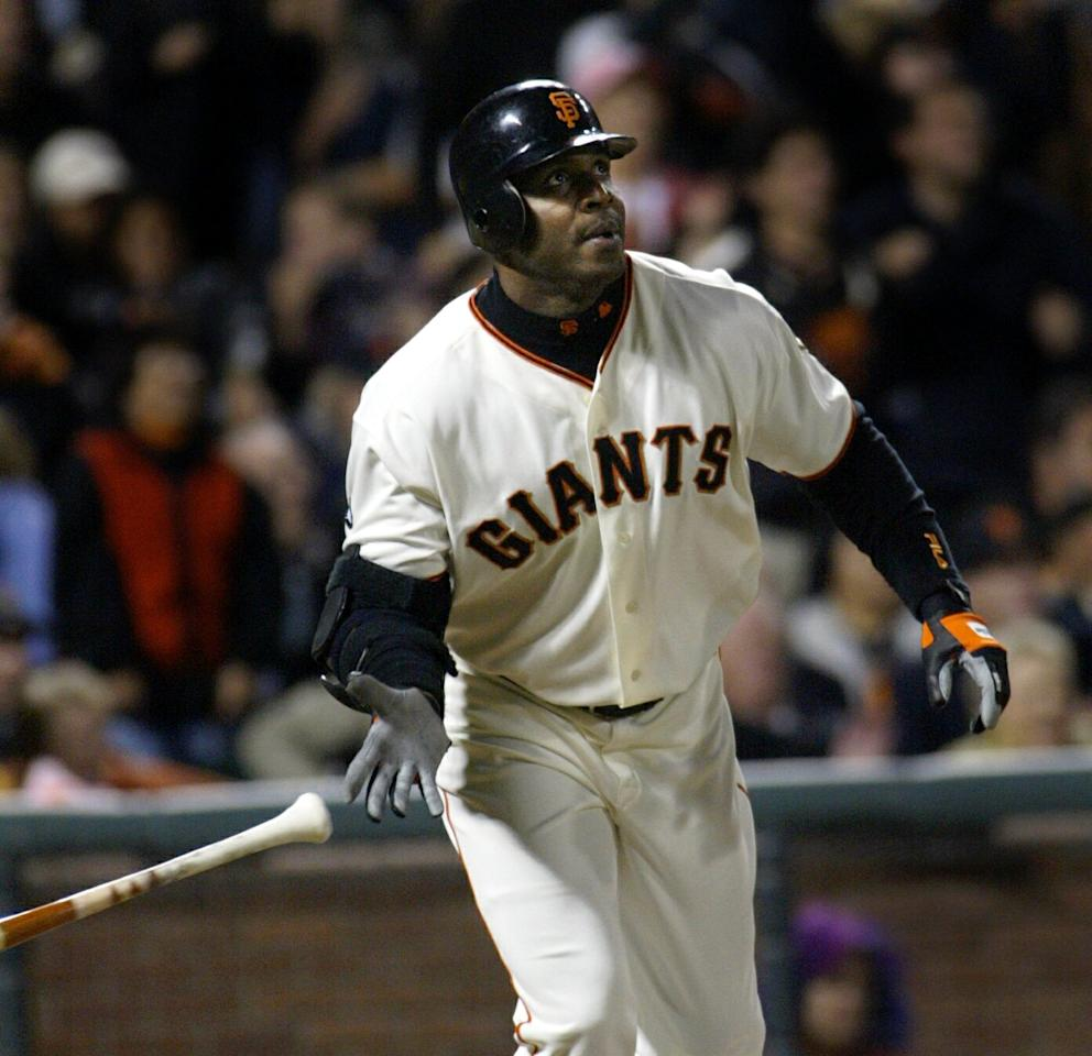 FILE - This Sept. 16, 2003, file photo shows San Francisco Giants' Barry Bonds watching the flight of his 656th career home run off San Diego Padres pitcher Adam Eaton, in the fifth inning, in San Francisco. More than three years after Barry Bonds was first indicted, his federal trial is finally nearing its end. The record-setting baseball star is charged with three counts of lying to a grand jury in December 2003.