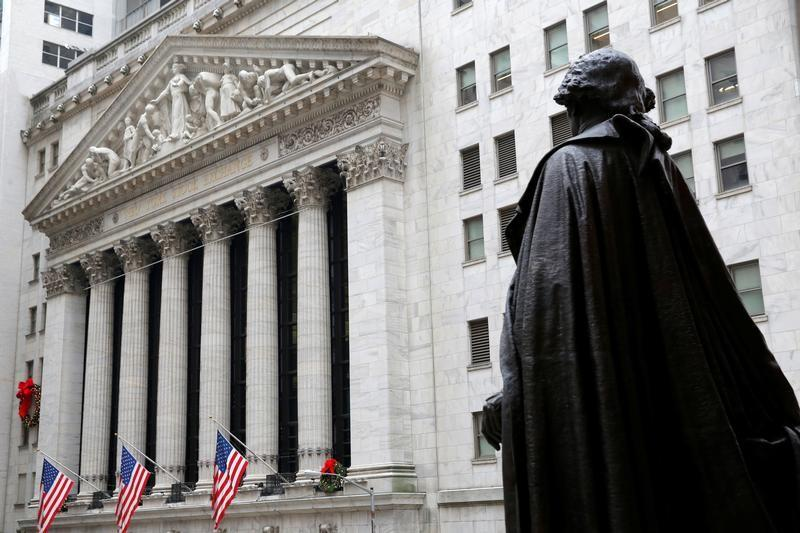 A statue of George Washington stands across from the New York Stock Exchange in Manhattan, New York City
