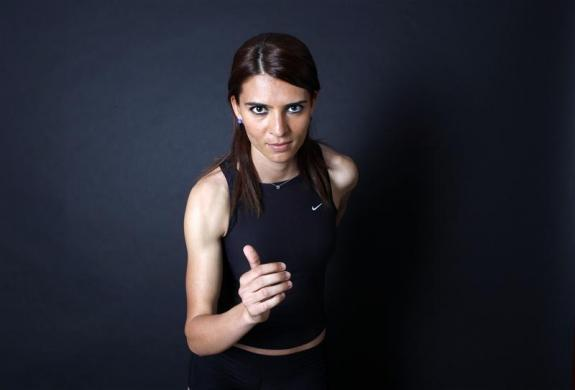 "Turkish 800-meter runner and Olympic hopeful Merve Aydin, 22, poses for a picture in Ankara May 23, 2012. Aydin will run at the Olympics for the first time this year. Her daily intake is 3000 kcal. Although she is rigorously training for the Games, she remains guarded on the outcome. ""It is more important for me to realize my true potential and limitations. And do the best I can. I work hard and keep a careful diet,"" she says."