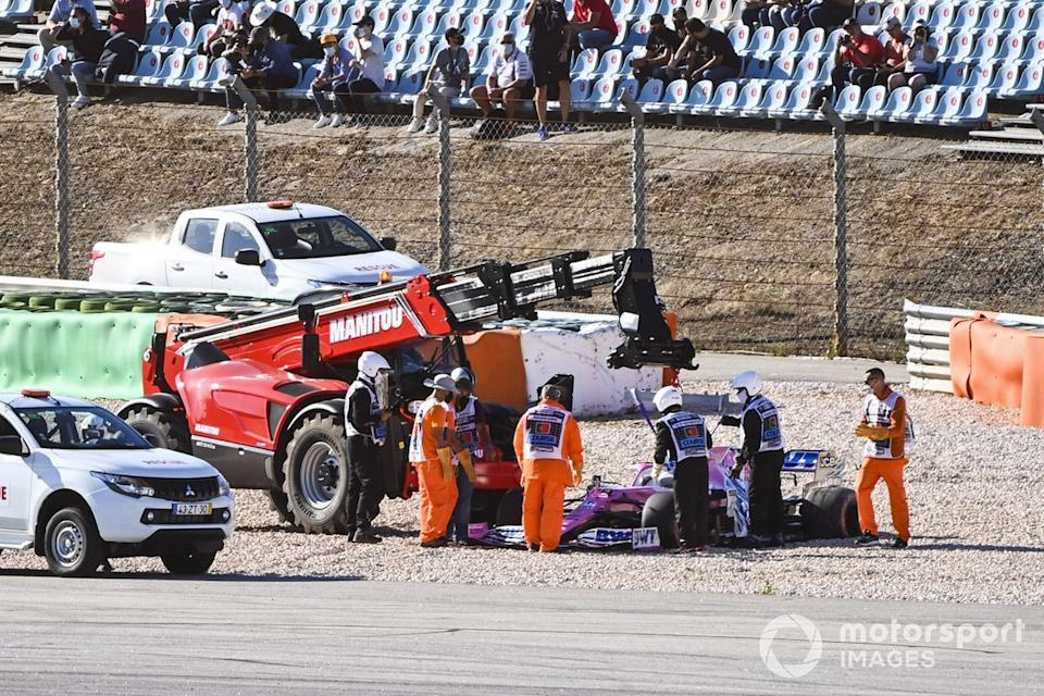 "Marshals remove the car of Lance Stroll, Racing Point RP20, after a collision with Max Verstappen, Red Bull Racing RB16, during FP2<span class=""copyright"">Mark Sutton / Motorsport Images</span>"