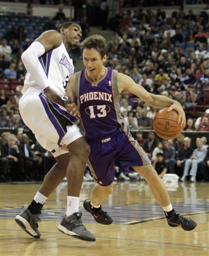 Phoenix Suns guard Steve Nash, right, drives past Sacramento Kings forward Jason Thompson during the first quarter of an NBA basketball game in Sacramento, Calif., Tuesday, April 3, 2012.(AP Photo/Rich Pedroncelli)