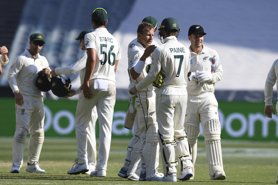 New Zealand and Australian players shake hands after the cricket test match in Melbourne, Australia, Sunday, Dec. 29, 2019. (AP Photo/Andy Brownbill)