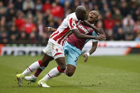 Britain Football Soccer - Stoke City v West Ham United - Premier League - bet365 Stadium - 29/4/17 West Ham United's Andre Ayew in action with Stoke City's Bruno Martins Indi Reuters / Andrew Yates Livepic