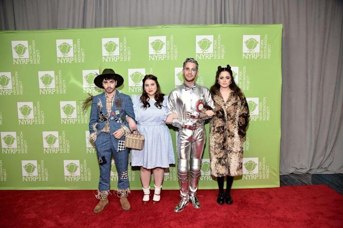 """<p>You can never go wrong with <a href=""""https://www.womansday.com/style/fashion/g28798361/wizard-of-oz-diy-costumes/"""" rel=""""nofollow noopener"""" target=""""_blank"""" data-ylk=""""slk:Wizard of Oz costumes"""" class=""""link rapid-noclick-resp""""><em>Wizard of Oz</em> costumes</a>, and a group costume that includes Dorothy, the Scarecrow, the Tin Man, and the Cowardly Lion can't be beat. </p><p><a class=""""link rapid-noclick-resp"""" href=""""https://www.amazon.com/ZAFUL-Adjustable-Spaghetti-Sleeveless-Checkered/dp/B07N4PH7VD?tag=syn-yahoo-20&ascsubtag=%5Bartid%7C10070.g.3083%5Bsrc%7Cyahoo-us"""" rel=""""nofollow noopener"""" target=""""_blank"""" data-ylk=""""slk:SHOP BLUE GINGHAM DRESS"""">SHOP BLUE GINGHAM DRESS</a></p>"""