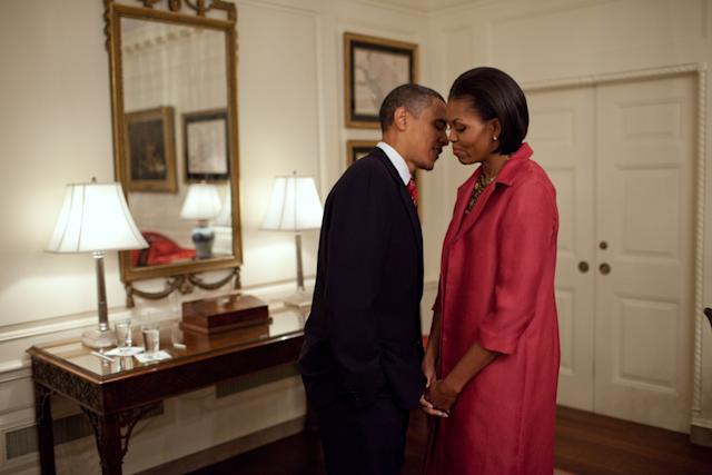 President Barack Obama and first lady Michelle Obama wait in the Map Room of the White House before welcoming President Felipe Calderón of Mexico on May 19, 2010.