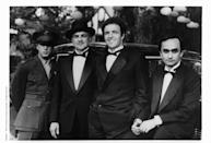 <p>Pacino, James Caan, and John Cazale, who play the Corleone brothers, pose with Brando (second from left), while on set of the first film. </p>