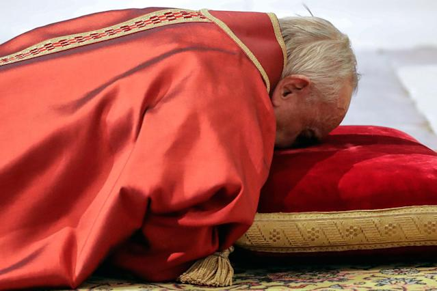 <p>Pope Francis lies down in prayer during the Good Friday Passion of Christ Mass inside St. Peter's Basilica, at the Vatican, Friday, March 30, 2018. Pope Francis began the Good Friday service at the Vatican with the Passion of Christ Mass and hours later will go to the ancient Colosseum in Rome for the traditional Way of the Cross procession. (Photo: Andrew Medichini/AP) </p>