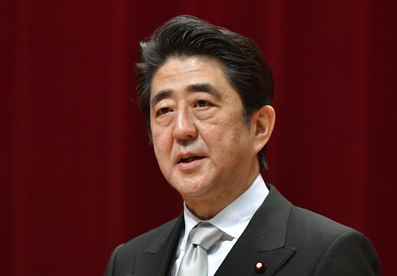 Japanese Prime Minister Shinzo Abe delivers a speech during the graduation ceremony of the National Defense Academy in Yokosuka, Kanagawa Prefecture on March 22, 2015