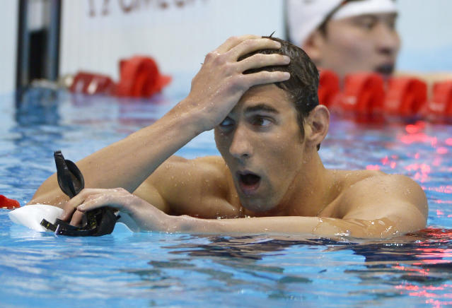 USA's Michael Phelps reacts after a men's 400-meter individual medley heat at the Aquatics Centre in the Olympic Park during the 2012 Summer Olympics in London, Saturday, July 28, 2012. (AP Photo/Mark J. Terrill)