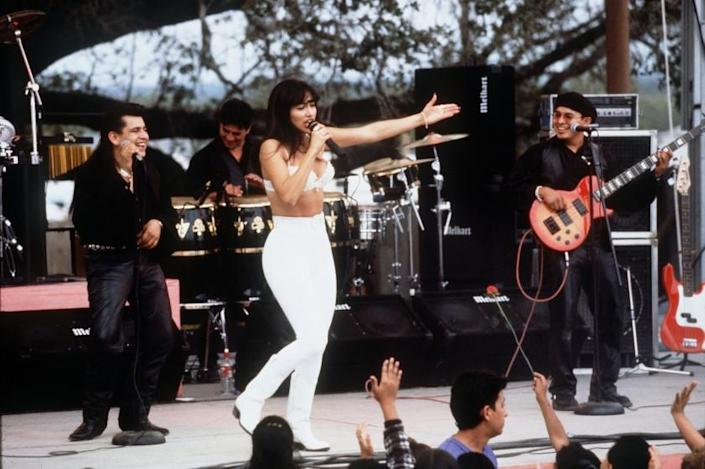 "Jennifer Lopez as Tejano singer Selena Quintanilla in the 1997 biopic ""Selena."""