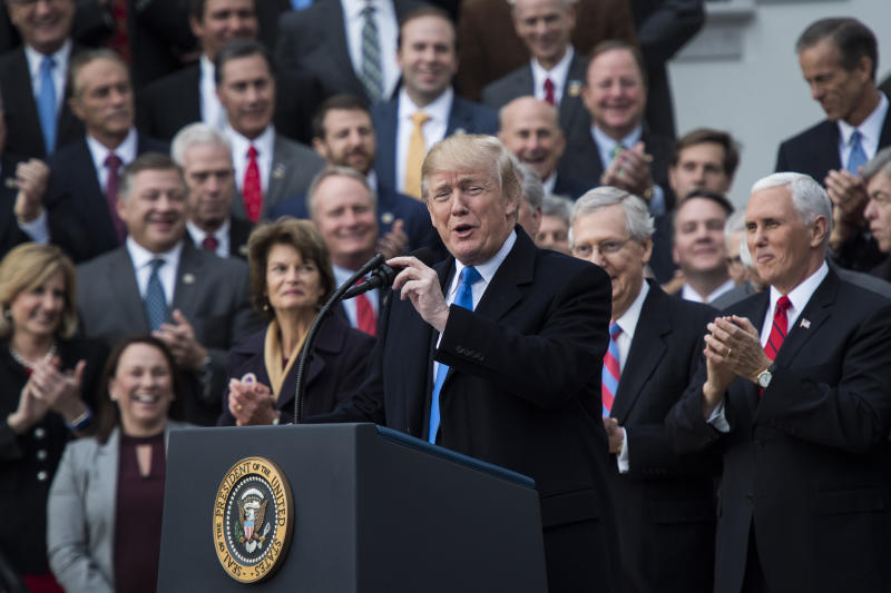 President Donald Trump praises the Republican tax cut on Dec. 20. (The Washington Post via Getty Images)