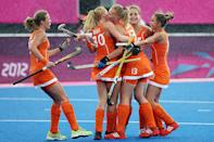 Caia Van Maasakker of Netherlands celebrates scoring her team's third goal with her team mates during the Women's Pool WA Match W02 between the Netherlands and Belgium at the Hockey Centre on July 29, 2012 in London, England. (Photo by Daniel Berehulak/Getty Images)