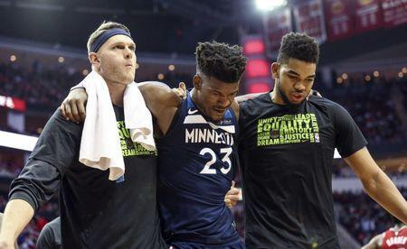 Feb 23, 2018; Houston, TX, USA; Minnesota Timberwolves guard Jimmy Butler (23) is helped off the court by teammates after an apparent injury during the third quarter against the Houston Rockets at Toyota Center. Mandatory Credit: Troy Taormina-USA TODAY Sports