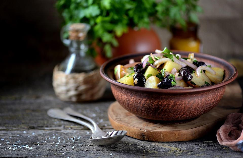 """<p>If you don't like using mayonnaise but want something more exciting than a white vinegar-based potato salad, this Niçoise-inspired potato salad will be your new favorite dish. For this, a tasty mustard <a href=""""https://www.thedailymeal.com/how-make-vinaigrette?referrer=yahoo&category=beauty_food&include_utm=1&utm_medium=referral&utm_source=yahoo&utm_campaign=feed"""" rel=""""nofollow noopener"""" target=""""_blank"""" data-ylk=""""slk:vinaigrette dressing"""" class=""""link rapid-noclick-resp"""">vinaigrette dressing</a> takes the place of mayonnaise in a classic American potato salad mixed with traditional French ingredients like olives and capers.</p> <p><a href=""""https://www.thedailymeal.com/recipes/potato-salad-olives-capers-and-mustard-vinaigrette-0-recipe?referrer=yahoo&category=beauty_food&include_utm=1&utm_medium=referral&utm_source=yahoo&utm_campaign=feed"""" rel=""""nofollow noopener"""" target=""""_blank"""" data-ylk=""""slk:For the Potato Salad With Olives, Capers, and Mustard Vinaigrette recipe, click here."""" class=""""link rapid-noclick-resp"""">For the Potato Salad With Olives, Capers, and Mustard Vinaigrette recipe, click here.</a></p>"""