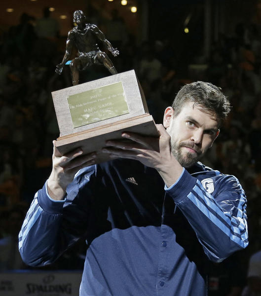 Memphis Grizzlies center Marc Gasol, of Spain, holds the NBA Defensive Player of the Year trophy before Game 3 in a first-round NBA basketball playoff series against Los Angeles Clippers in Memphis, Tenn., Thursday, April 25, 2013. (AP Photo/Danny Johnston)