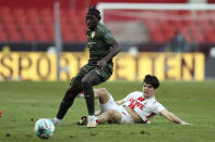 Stuttgart's Tanguy Coulibaly, left, and Cologne's Elvis Rexhbe challenge for the ball during the German Bundesliga soccer match between 1. FC Cologne and VfB Stuttgart in Cologne, Germany, Saturday, Feb. 20, 2021. ( Rolf Vennenbernd/dpa via AP)