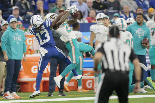 FILE - In this Nov. 25, 2018, file photo, Miami Dolphins cornerback Xavien Howard (25) intercepts a pass intended for Indianapolis Colts quarterback Andrew Luck (12) during the first half of an NFL football game in Indianapolis. Howard leads the NFL in interceptions, and his takeaway skills are a big reason the Miami Dolphins are in the playoff picture despite a soft defense and sputtering offense. (AP Photo/AJ Mast, File)
