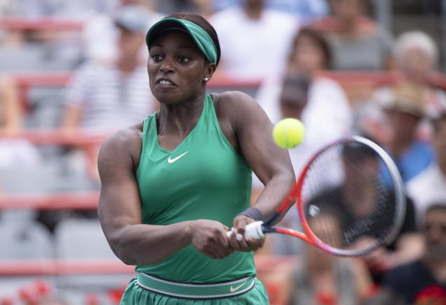 Sloane Stephens, of the United States, returns to Francoise Abanda, of Canada, during the Rogers Cup women's tennis tournament, Wednesday, Aug. 8, 2018, in Montreal. (Paul Chiasson/The Canadian Press via AP)