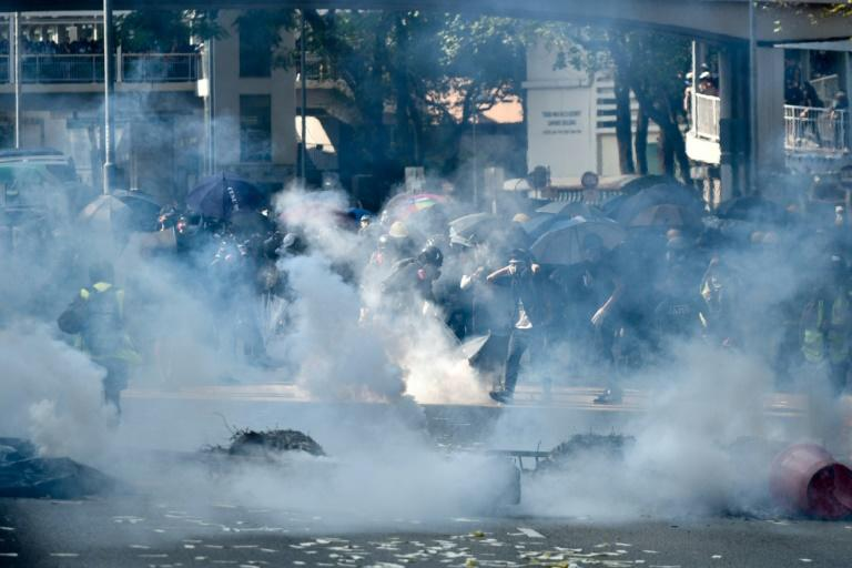 Police fired tear gas to disperse protesters in Tsuen Wan district (AFP Photo/Philip FONG)
