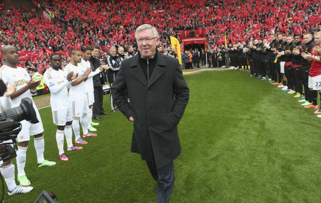 MANCHESTER, ENGLAND - MAY 12: Manager Sir Alex Ferguson of Manchester United is given a guard of honour by both teams ahead of the Barclays Premier League match between Manchester United and Swansea at Old Trafford on May 12, 2013 in Manchester, England. (Photo by John Peters/Man Utd via Getty Images)