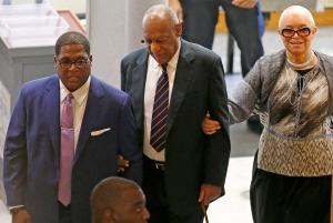Bill Cosby (center) with his wife, Camille (right), in court on June 12.