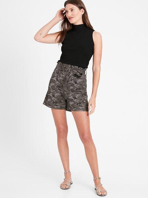 """<p><strong>Banana Republic</strong></p><p>bananarepublic.gap.com</p><p><strong>$69.50</strong></p><p><a href=""""https://go.redirectingat.com?id=74968X1596630&url=https%3A%2F%2Fbananarepublic.gap.com%2Fbrowse%2Fproduct.do%3Fpcid%3D1040705%26pid%3D669473&sref=https%3A%2F%2Fwww.thepioneerwoman.com%2Ffashion-style%2Fg36608512%2Fbest-high-waisted-shorts%2F"""" rel=""""nofollow noopener"""" target=""""_blank"""" data-ylk=""""slk:Shop Now"""" class=""""link rapid-noclick-resp"""">Shop Now</a></p><p>These pleated paperbag shorts feature a removable belt and a concealed elastic waist for all-day comfort. The charcoal gray color offers a sophisticated take on your favorite camo print. </p>"""