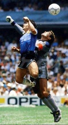 Diego Maradon and Peter Shilton in mid air.