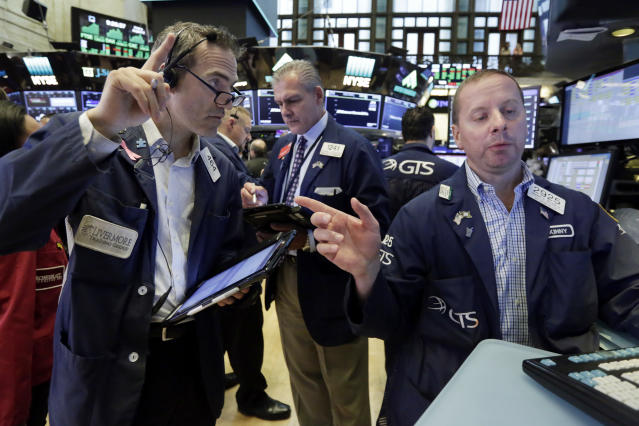 Specialist Robert Nelson, right, and trader Gregory Rowe, left, work on the floor of the New York Stock Exchange. (AP Photo/Richard Drew, File)