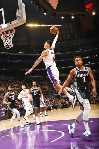 LOS ANGELES, CA - MARCH 24: Kyle Kuzma #0 of the Los Angeles Lakers drives to the basket during the game against the Sacramento Kings on March 24, 2019 at STAPLES Center in Los Angeles, California. (Photo by Andrew D. Bernstein/NBAE via Getty Images)