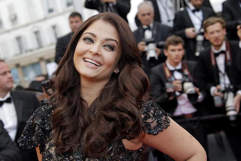Actress Aishwarya Rai poses for photographers as she arrives for the screening of the film Inside Llewyn Davis at the 66th international film festival, in Cannes, southern France, Sunday, May 19, 2013. (AP Photo/Francois Mori)