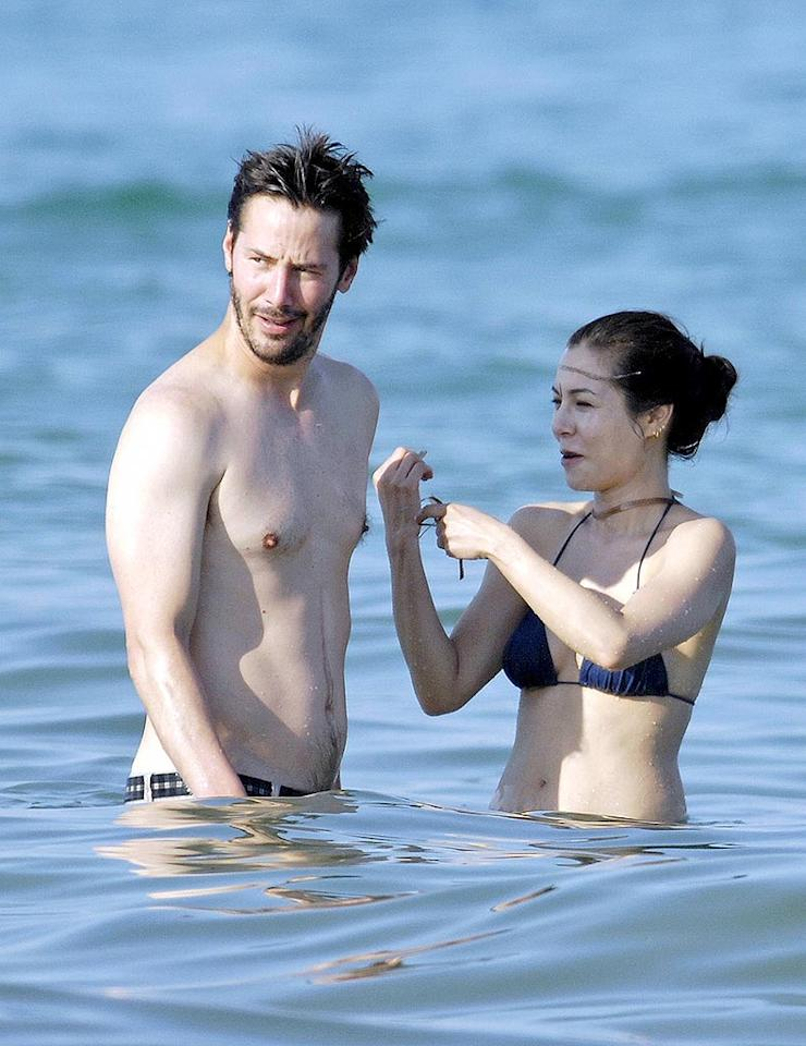 "Keanu Reeves and his latest girlfriend China Chow splash in the sea while vacationing in Saint Tropez. SP/<a href=""http://www.x17online.com"" target=""new"">X17 Online</a> - June 25, 2008"