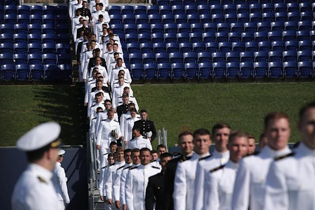 <p>Members of Class of 2018 enter the Navy-Marine Corps Memorial Stadium during a graduation ceremony at the U.S. Naval Academy May 25, 2018 in Annapolis, Md. (Photo: Alex Wong/Getty Images) </p>
