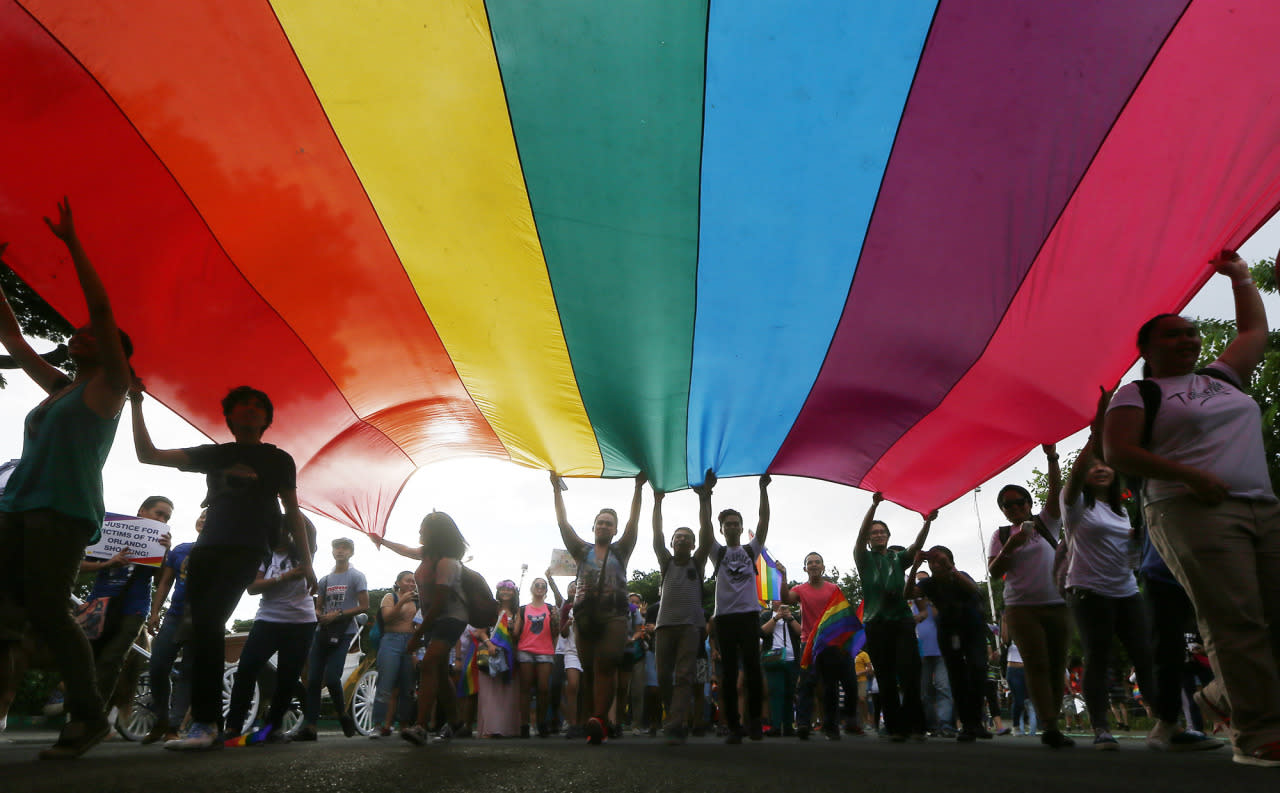 "<p>Members of LGBT carry a huge rainbow flag as they march around the Rizal Park to celebrate the annual ""Pride March"", June 25, 2016 in Manila, Philippines. Several LGBT organizations are one in calling for the passage of the Anti-Discrimination bill that they say would protect the LGBT community. (Photo: Bullit Marquez/AP) </p>"