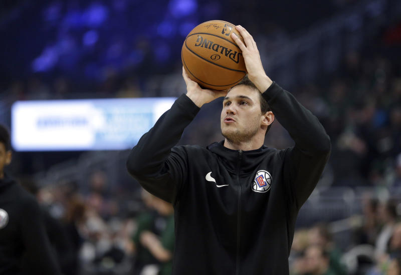 LA Clippers' Danilo Gallinari warms up before an NBA basketball game against the Milwaukee Bucks Thursday, March 28, 2019, in Milwaukee. (AP Photo/Aaron Gash)