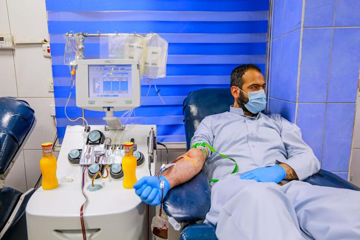 A recovered coronavirus patient donates blood samples for plasma extraction to help critically ill patients on June 22, 2020.