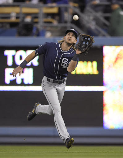 San Diego Padres center fielder Travis Jankowski makes the catch on a ball hit by Los Angeles Dodgers' Chris Taylor during the seventh inning of a baseball game Friday, May 25, 2018, in Los Angeles. (AP Photo/Mark J. Terrill)