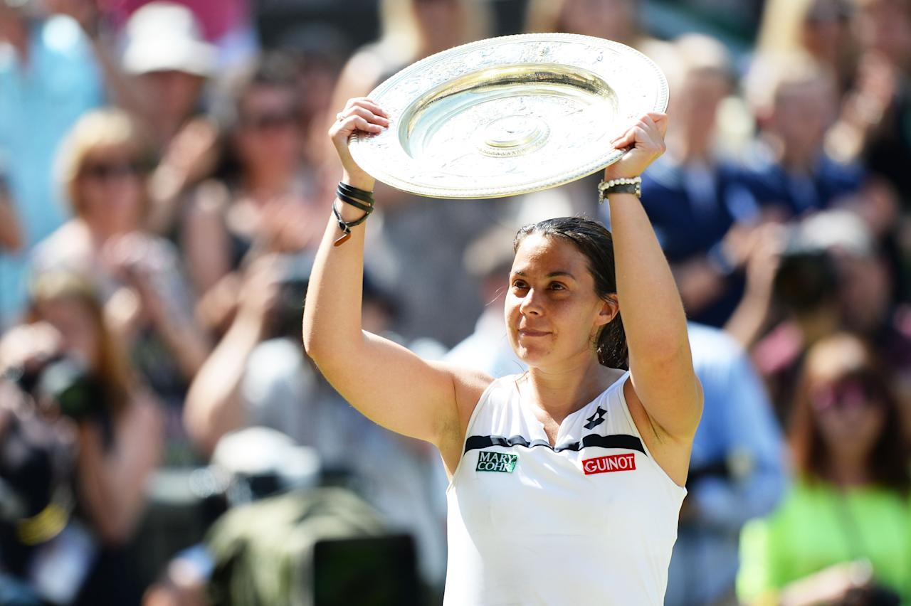LONDON, ENGLAND - JULY 06: Marion Bartoli of France poses with the Venus Rosewater Dish trophy after her victory in the Ladies' Singles final match against Sabine Lisicki of Germany on day twelve of the Wimbledon Lawn Tennis Championships at the All England Lawn Tennis and Croquet Club on July 6, 2013 in London, England. (Photo by Mike Hewitt/Getty Images)