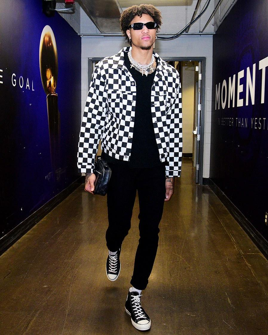 """<h1 class=""""title"""">March 14: Kelly Oubre Jr.</h1> <div class=""""caption""""> Kelly Oubre Jr. will dunk on your head and then sing My Chemical Romance at karaoke after the game. </div> <cite class=""""credit"""">Michael Gonzales</cite>"""