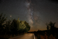 <p>A road in Berducedo, Spain, plays host to stunning views of the Milky Way on Sunday night (Reuters) </p>
