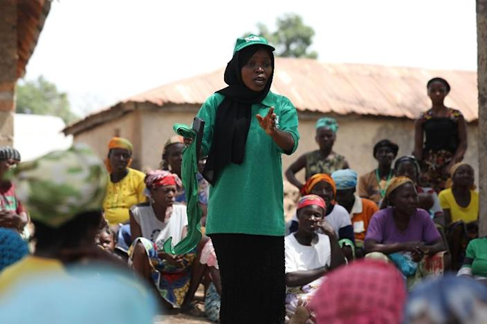Binta Mohammed, a National Cash Transfer Officer, provides advice on how to make funds from the programme go further (AFP Photo/Kola SULAIMON)