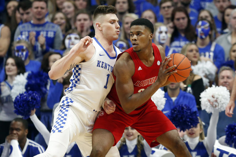 Louisville's Steven Enoch, right, looks for an opening on Kentucky's Nate Sestina during the first half of an NCAA college basketball game in Lexington, Ky., Saturday, Dec. 28, 2019. (AP Photo/James Crisp)