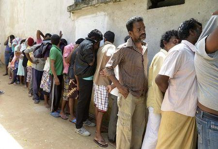 Sri Lankan asylum seekers who were sent back by Australia wait to enter a magistrate's court in Galle
