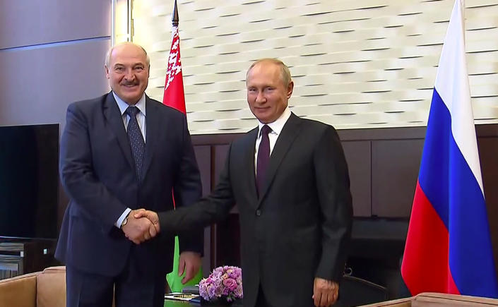 In this photo taken from video and released by Russian Presidential Press Service, Russian President Vladimir Putin, right, and Belarusian President Alexander Lukashenko shake hands during their meeting in the Bocharov Ruchei residence in the Black Sea resort of Sochi, Russia, Monday, Sept. 14, 2020. Belarus' authoritarian president is visiting Russia in a bid to secure more loans and political support as demonstrations against the extension of his 26-year rule enter their sixth week. Alexander Lukashenko's talks Monday with Russian President Vladimir Putin in the Black Sea resort of Sochi come a day after an estimated 150,000 flooded the streets of the Belarusian capital, demanding Lukashenko's resignation. (Russian Presidential Press Service via AP)