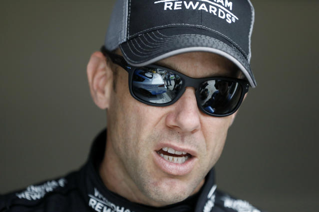"Driver <a class=""link rapid-noclick-resp"" href=""/nascar/sprint/drivers/81/"" data-ylk=""slk:Matt Kenseth"">Matt Kenseth</a> stands in the garage area before a practice run for this weekend's NASCAR Cup Series auto race at Kansas Speedway Friday, May 11, 2018, in Kansas City, Kan. (AP Photo/Colin E. Braley)"