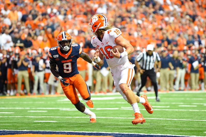 Clemson Tigers quarterback Trevor Lawrence (16) looks back at Syracuse Orange defensive back Evan Foster (9) while running into the end zone for a touchdown. (USAT)